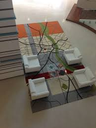 the new rug in our office lobby is a map of the city the red dot