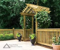 pictures of gabled walk through arbor with 2x2 fence open at