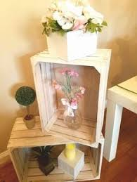baby block centerpiece with hydrangea roses babies breath and a
