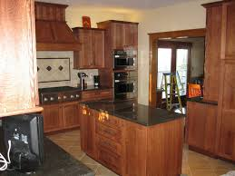 quartersawn oak cabinets in a rustic kitchen decora cabinetry
