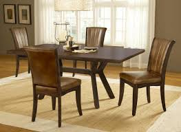 traditional casual dining room design with mahogany stain table at