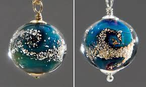 cremation remains custom glass planets containing the cremated remains of loved ones