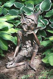 large pixie sitting garden ornament aged bronze effect cast in