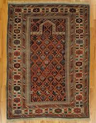 this dazzling antique afghan prayer rug displays a fantastic