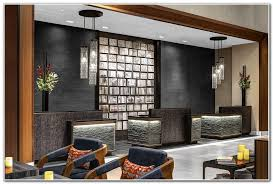 hotel front desk jobs nyc dark brown sectional couch dark brown leather sectional couch