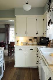 Simple White Kitchen Cabinets Kitchen Angelic Artistry Pure White Galley Mid Continent Kitchen