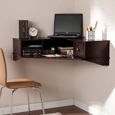 dark stained wooden wall mounted floating desk with shelf and book