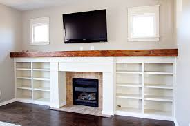 custom fireplace surround bookshelves reclaimed wood mantle