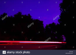 sunset car lights motion blur timed exposure mountain curve stock