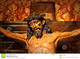 jesus on the cross carved in polychrome wood stock photo image