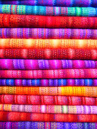 pink and blue textile near yellow textile free stock photo