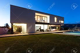 modern lifestyle images stock pictures royalty free modern modern lifestyle modern villa with pool view from garden night scene stock photo