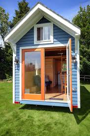 best ideas about tiny houses canada pinterest loft stairs tiny blue house with double doors and plenty high quality features
