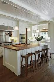 white kitchen island breakfast bar contemporary minimalist kitchen design with white sleek waterfall