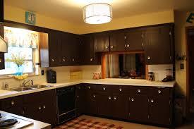 espresso kitchen cabinets with white countertop in white kitchen