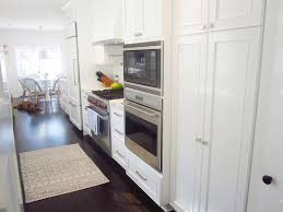 cococozy exclusive chic galley kitchen interior homes this galley kitchen features everything home chef would want uble ovens wolf gas range and high end refrigerator with panel doors matching the