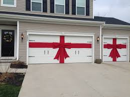 Tasteful Outdoor Christmas Decorations - diy red burlap ribbon and bow for christmas decor for garage doors