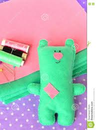 funny felt bear thread needle pins on fabric background home