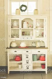 are antique white kitchen cabinets in style antique white kitchen cabinet filled with cookware stock photo image now