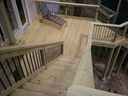 light brown wooden tread and riser of staircase with black metal