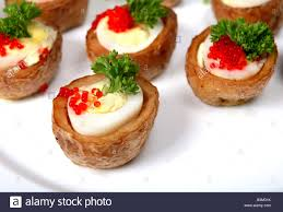baked canapes a plate of quails egg canapes the eggs are in tiny baked jacket