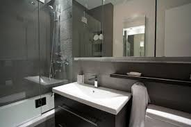 black wooden bathroom vanity using gray marble countertop also