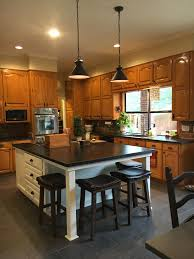 wood kitchen cabinets with white island updated kitchen with new white island original honey oak