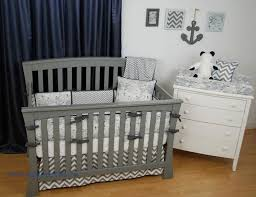 navy and grey nautical crib bedding with chevron and world map