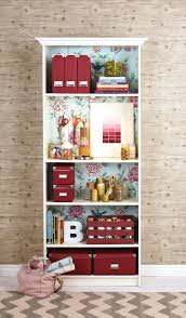 how to makeover your bookcase craft station fancy and wallpaper