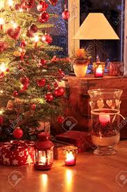 illuminated christmas tree in german home with candlelights stock