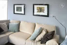 living room with cream sofa soft blue wall interior design stock
