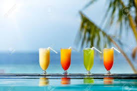 cocktail drinks on the beach fresh summer cocktails drinks placed next to swimming pool with