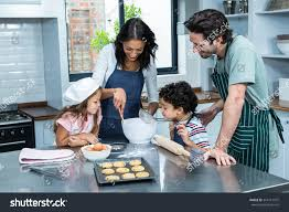 happy family cooking biscuits together kitchen stock photo