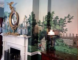 fireplace american empire girandole mirror in dining room of