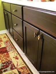 using polyshades to darken our wood cabinets stain cabinets