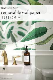 removable wallpaper in the downstairs powder room and walls need