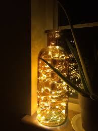 a large decorative bottle with 100 firefly led lights inside