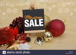 sale banner with decoration ornaments balls pine bells