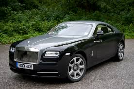 roll royce modified rolls royce wraith on the bed of grass