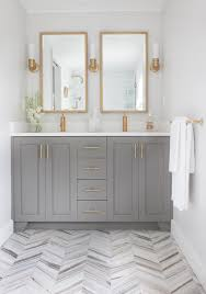 brass bathroom mirror how to mix metal finishes in a bathroom
