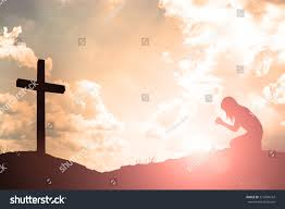 silhouette praying cross beautiful stock photo