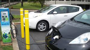 electric cars charging electric car charging station blocked get an extension cord