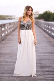 cream and black sequined maxi dress with crochet back maxi