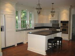 Pictures Of Kitchen Islands With Sinks White Cabinets With Chunky Crown Moulding And Huge Window Over
