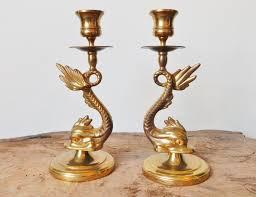 asian dolphin ring holder images Brass sea serpent candlestick holders matching pair brass sea jpg