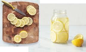 diy project a mason jar lemon u0026 flower centerpiece rue now