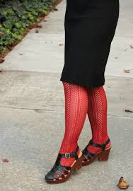 file orange patterned tights with a black dress for halloween