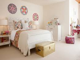 bedroom wall decor with white headboard and bedding also storage
