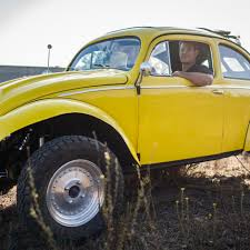 baja bug lowered tesla u0027s invisible solar panels are a big deal to suburbanite