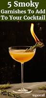 manhattan drink illustration here are five scorched and torched cocktail garnishes that will